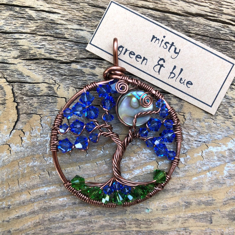 wire tree necklace with blue crystal leaves and green crystal ground